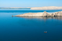 Pag Island. Alone boat, lighthouse and ruins on island pag in croatia Royalty Free Stock Images