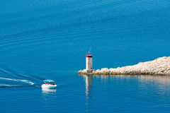 Pag Island. Boat and lighthouse on island pag in croatia Royalty Free Stock Images