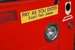 Paga come fornite il segno sul bus Fotografia Stock Libera da Diritti