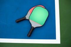 Pagaia e palla di Pickleball Fotografia Stock