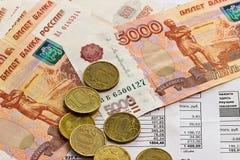 Pagamento das utilidades e do dinheiro Fotos de Stock Royalty Free