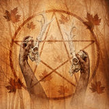 Pagan Forest Ritual. Pagan ritual graphic with hands upholding two stag skulls against a forest background overlaid with a pentagram Royalty Free Stock Photo