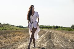 Pagan Gypsy woman on the dirty road stock photography