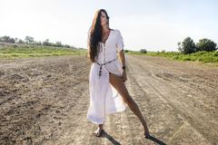 Pagan Gypsy woman on the dirty road stock images