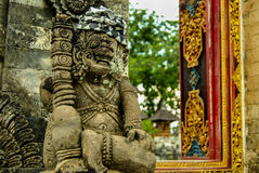 Pagan sculpture - traditional Balinese God statue in Hindu temple Stock Photo