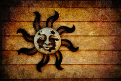 Pagan Sun Symbol background with Texture Added. A broken, decaying pagan sun symbol with artistic, grunge style texture added and room for your text or images stock photography