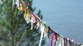 Pagan symbols colorful cloth on the rope for spirits. Religious video stock footage