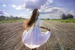 Pagan Woman dancing on the dirty road stock photos