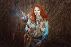Pagan woman is a sorcerer. Royalty Free Stock Photos