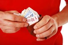 Pagando con gli euro Immagini Stock Libere da Diritti