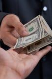 Pagando dólares Fotografia de Stock Royalty Free
