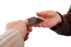 Pagando dalla carta di credito Fotografia Stock