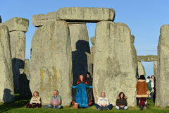 Pagans Mark the Autumn Equinox at Stonehenge. Pagans and druids celebrate the autumn equinox at the ancient standing stone monument on September 23, 2015 in Stock Photo