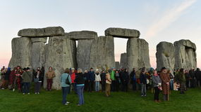Pagans Mark the Autumn Equinox at Stonehenge. Pagans and druids celebrate the spring equinox at the ancient standing stones on September 23, 2015 in Stonehenge Stock Photography