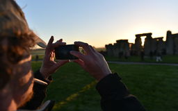 Pagans Mark the Autumn Equinox at Stonehenge. Pagans and druids celebrate the spring equinox at the ancient standing stones on September 23, 2015 in Stonehenge Royalty Free Stock Photos