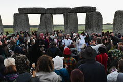 Pagans Mark the Autumn Equinox at Stonehenge. Pagans and druids celebrate the spring equinox at the ancient standing stones on September 23, 2015 in Stonehenge stock photo