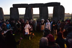 Pagans Mark the Autumn Equinox at Stonehenge. Pagans and druids celebrate the spring equinox at the ancient standing stones on September 23, 2015 in Stonehenge Stock Image