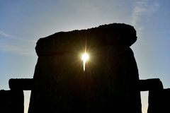 Pagans Mark the Autumn Equinox at Stonehenge. The Sun Rises against a Silhouetted Stonhenge as Pagans and Druids Celebrate the Spring Equinox at the Ancient Royalty Free Stock Image