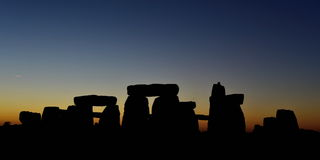 Pagans Mark the Autumn Equinox at Stonehenge. The sun rises at Stonhenge as pagans and druids celebrate the spring equinox at the ancient standing stones on Stock Photography