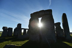 Pagans Mark the Autumn Equinox at Stonehenge. The sun rises at Stonhenge as pagans and druids celebrate the spring equinox at the ancient standing stones on Stock Images