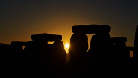 Pagans Mark the Autumn Equinox at Stonehenge. The sun rises at Stonhenge as pagans and druids celebrate the spring equinox at the ancient standing stones on stock photo
