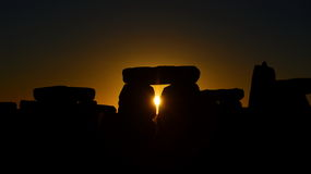 Pagans Mark the Autumn Equinox at Stonehenge. The sun rises at Stonhenge as pagans and druids celebrate the spring equinox at the ancient standing stones on Royalty Free Stock Photography