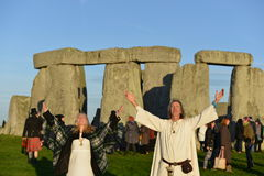 Pagans Mark the Autumn Equinox at Stonehenge. The sun rises at Stonhenge as pagans and druids celebrate the spring equinox at the ancient standing stones on Stock Photos