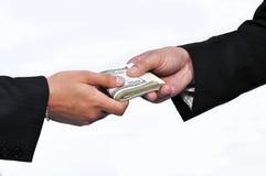 Pagar el dinero Imágenes de archivo libres de regalías