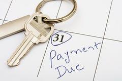 Pagar su hipoteca el tiempo imagen de archivo