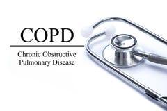 Page avec la bronchopneumopathie chronique obstructive de COPD sur les ventres photo stock