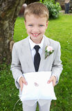 Page Boy Carrying Wedding Ring On Cushion. Smiling To Camera stock photos