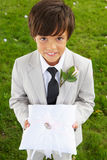 Page Boy Carrying Wedding Ring On Cushion royalty free stock photography