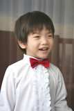 Page boy with red bow-tie smiling. 3 year old page boy with red bow-tie smiling Stock Image