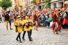 Page boys in medieval costumes Stock Image