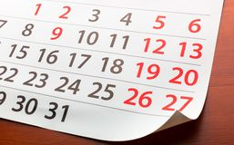 Page from calendar lies on the table Stock Photography