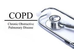Page with COPD Chronic obstructive pulmonary disease on the ta. Ble with stethoscope, medical concept stock photo