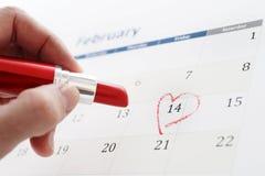Page de calendrier de février et peu de jour de valentines rouge d'inscription de coeur Images stock