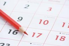 Page et crayon de calendrier Photo stock