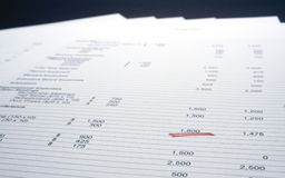 Page of figures. With a single figure underlined with red marker stock photos
