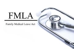 Page with FMLA family medical leave act on the table with stethoscope, medical concept stock image