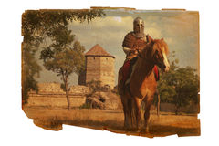Page of history of medieval Europe. Old yellowed sheet of paper with an image of a heavy knight Royalty Free Stock Image