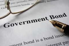Page of newspaper with words government bonds. Trading concept stock images