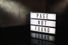 Page not found message on a light box. With a dark cinematic feel stock photography