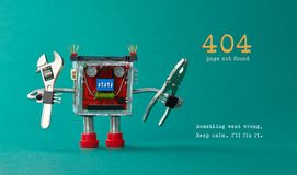Page not found template for website. Robot toy repairman with pliers adjustable wrench, 404 error warning message. Something went wrong, Keep calm I will fix it royalty free stock photography