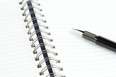 Page of notebook with black pen Royalty Free Stock Photo