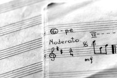 Page of an old musical notebook with hand written notes. Black and white