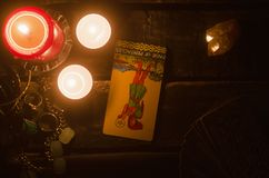 Tarot card. Future reading. Divination. Page of pentacles inverted Tarot card. Fortune teller royalty free stock photo