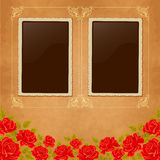 Page of photo album. Vintage background with old paper, photoframe, and red roses. Stock Photo
