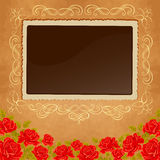 Page of photo album. Vintage background with old paper, photoframe, and red roses. Stock Image