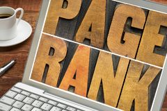 Page rank - SEO concept. Page rank - text in vintage letterpress wood type on a laptop screen - internet and SEO concept stock photo